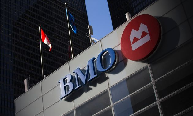 The Bank of Montreal logo at a bank branch in Toronto, March 5, 2013. BMO says it will cut five per cent...