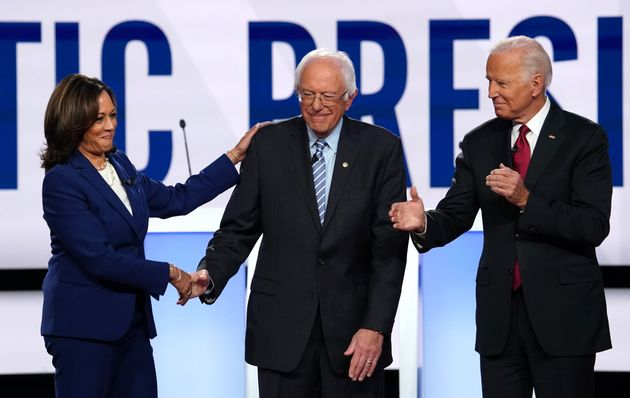 Kamala Harris greets Bernie Sanders and Joe Biden before the start of the U.S. Democratic presidential...