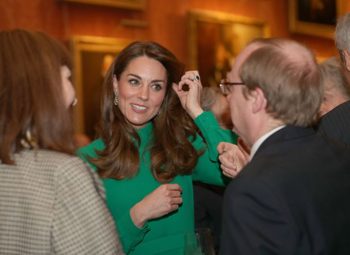 The Duchess of Cambridge greets guests at Buckingham Palace in central London on Dec. 3 during a reception hosted by Queen El