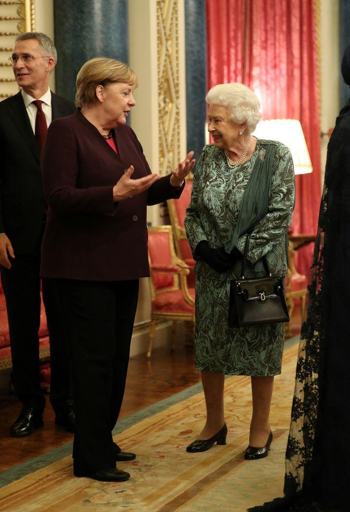 Queen Elizabeth talks with German Chancellor Angela Merkel.