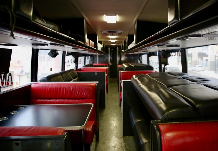 The refurbished bus features TVs, a kitchenette, washroom and fold out bunkbeds.