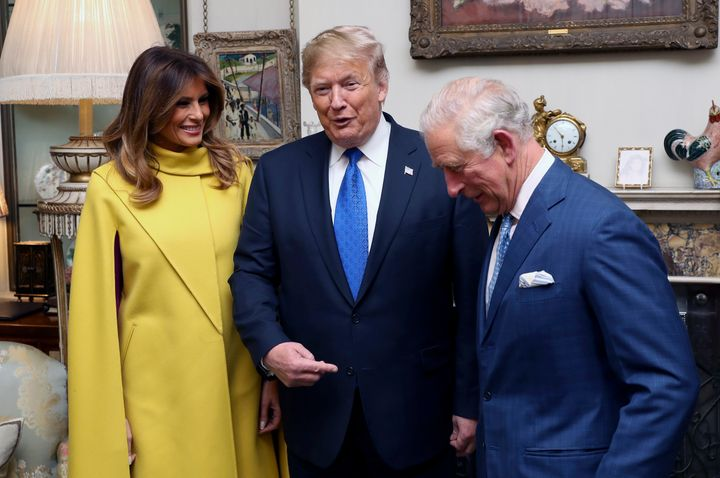 Britain's Prince Charles, right, poses for a photo with US President Donald Trump and first lady Melania, during a reception at Clarence House in London, Tuesday Dec. 3, 2019. Leaders from across the 29-member trans-Atlantic alliance are gathered in London to mark its 70th anniversary of NATO.  (Chris Jackson/Pool via AP)