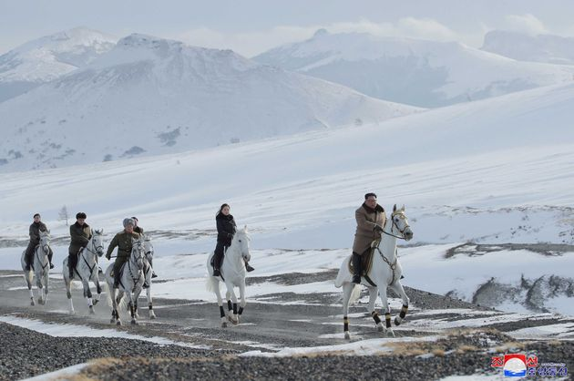 North Korean leader Kim Jong Un rides a horse while visiting battle sites in areas of Mt Paektu, Ryanggang,...