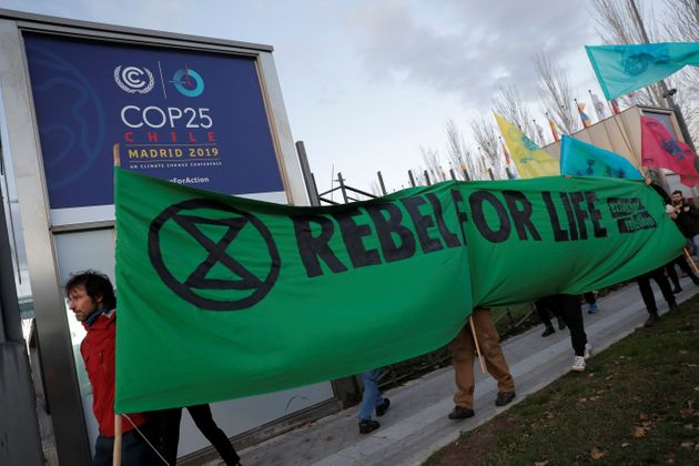 Members of the Extinction Rebellion group stage a protest Monday outside the venue of the United Nations...