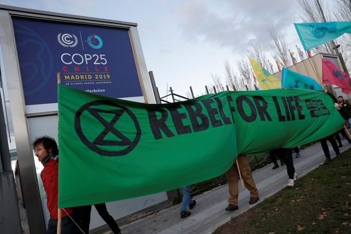 Members of the Extinction Rebellion group stage a protest Monday outside the venue of the United Nations climate change confe