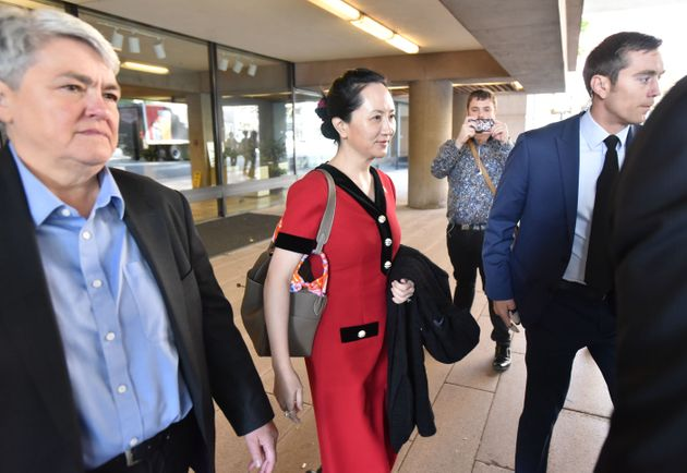 Huawei Chief Financial Officer, Meng Wanzhou, (center) leaves the British Columbia Supreme Court, in...