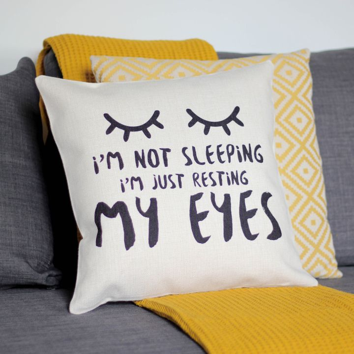 """<a href=""""https://fave.co/2OLHR9R"""" target=""""_blank"""" rel=""""noopener noreferrer"""">I&rsquo;m Not Sleeping Just Resting My Eyes Cushion, That&rsquo;s Nice That, Not On The High Street,</a> &pound;24.95"""