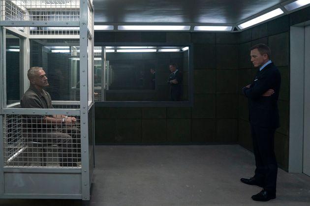 James Bond (Daniel Craig) visits Blofeld (Christoph Waltz) in his prison cell