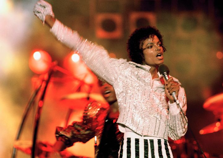 "Michael Jackson performs during the ""Victory Tour"" in 1984."