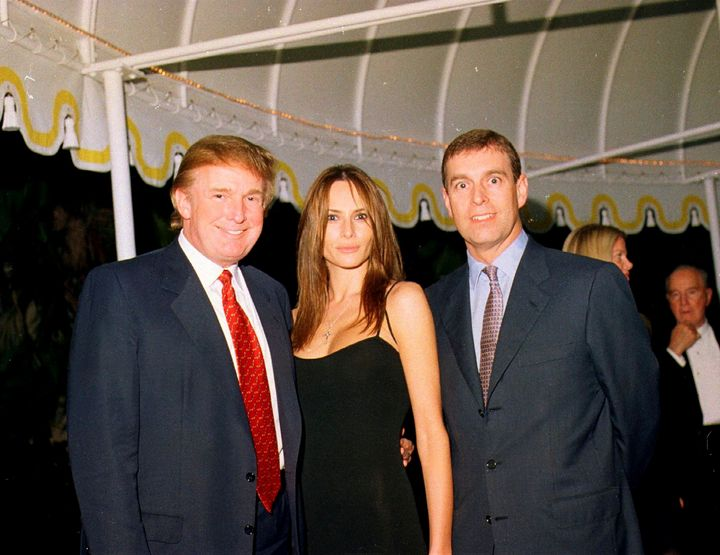 Donald Trump, his then-girlfriend Melania Knauss and Prince Andrew pose together at Mar-a-Lago in Palm Beach, Florida, on Feb