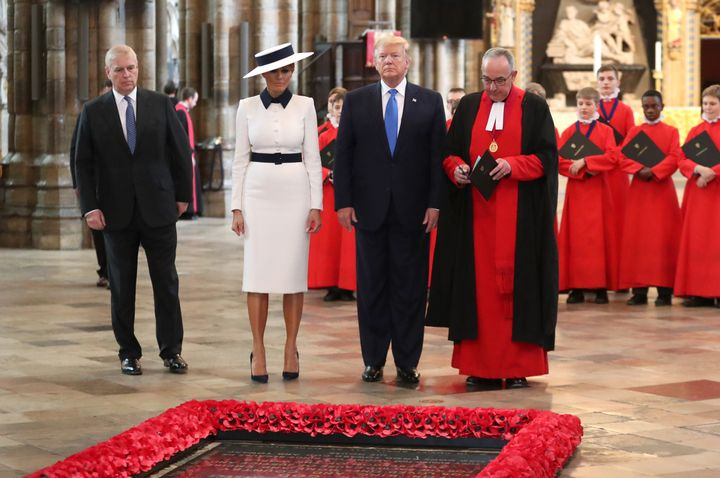The Duke of York (left) with Donald Trump, first lady Melania Trump and the dean of Westminster at the Grave of the Unknown W