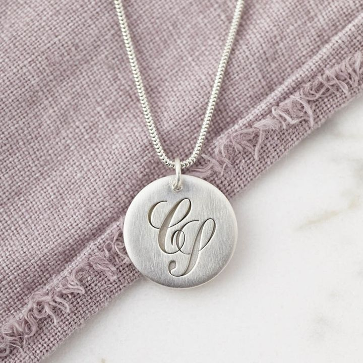 """<a href=""""https://fave.co/2OMfBnr"""">Sterling Silver Initial Monogram Necklace engraved with a hidden Secret Message on the reverse, Sally Clay, Etsy, </a>&pound;69"""