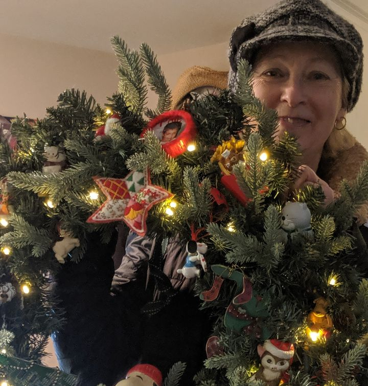 Janice holding the Christmas wreath she made for her son.