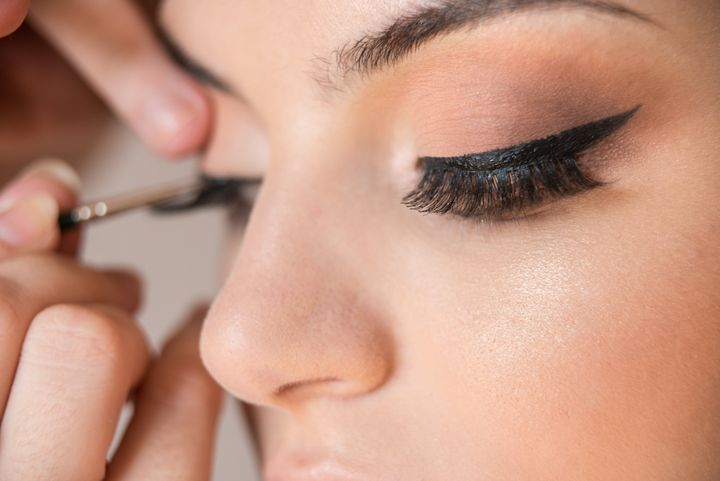 Applying eyeliner underneath the false lashes helps conceal any gaps between the lashes and your skin.