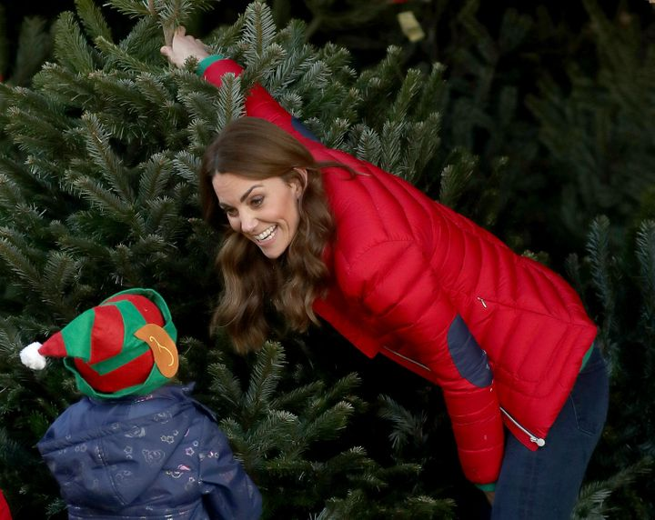 Kate spent time helping the children pick out Christmas trees.