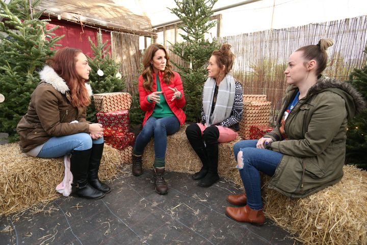 The Duchess of Cambridge talks to people who are supported by the Family Action charity.