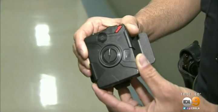 The officer's body camera, a similar one pictured, was designed to automatically record and save footage made two minutes bef