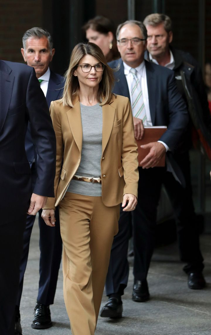 Actress Lori Loughlin and her husband, clothing designer Mossimo Giannulli depart federal court in Boston on April 3, 2019, after facing charges in a nationwide college admissions bribery scandal.