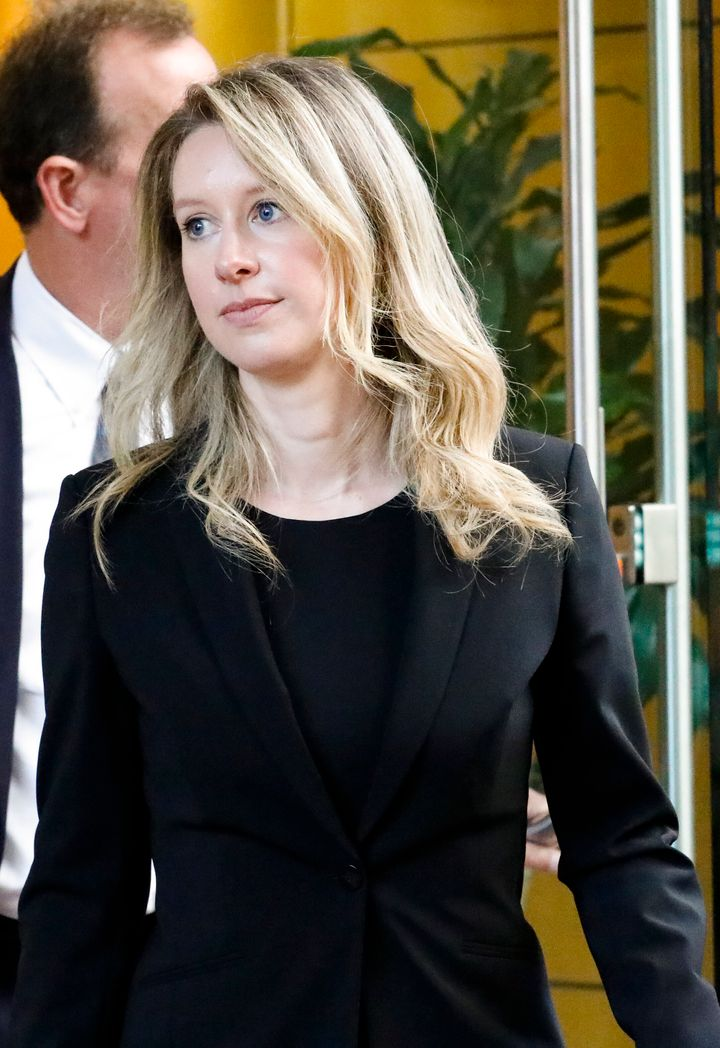 Elizabeth Holmes leaves court on July 17, 2019 without her signature heavy makeup.