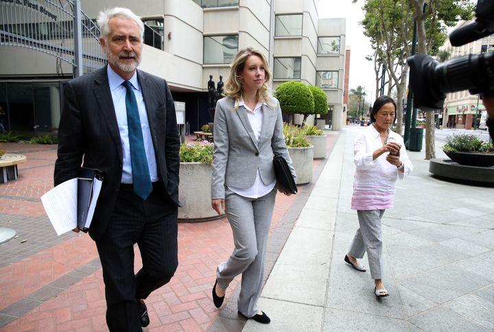 Elizabeth Holmes leaves U.S. Federal Court on June 28, 2019, in a gray suit.