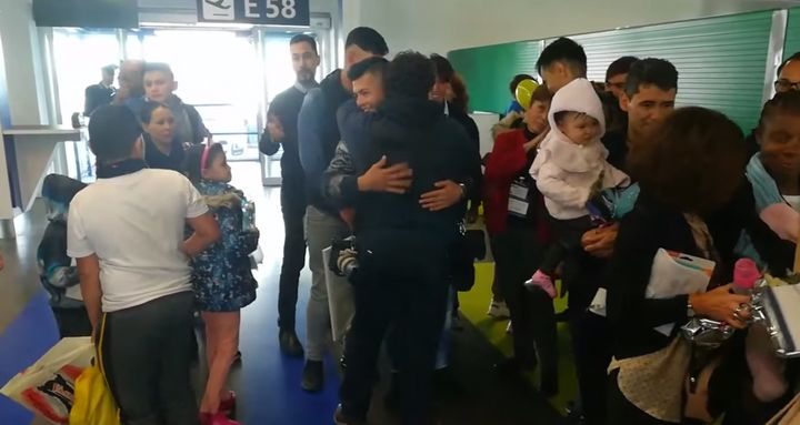Thirty-three migrants are greeted by Catholic volunteers at Rome'sFiumicino Airport on Wednesday, Dec. 4, 2019.