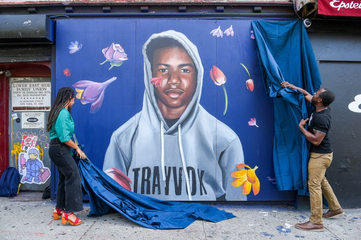 George Zimmerman was acquitted of murder in the death of Trayvon Martin, who's seen on a New York City mural in 2018.
