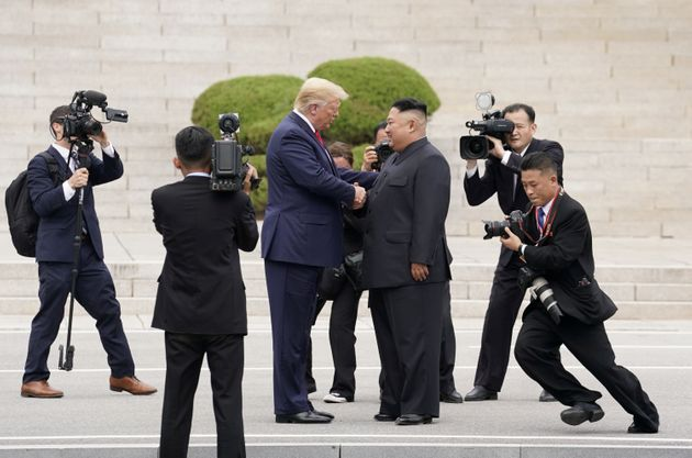 U.S. President Donald Trump meets with North Korean leader Kim Jong Un at the demilitarized zone separating...