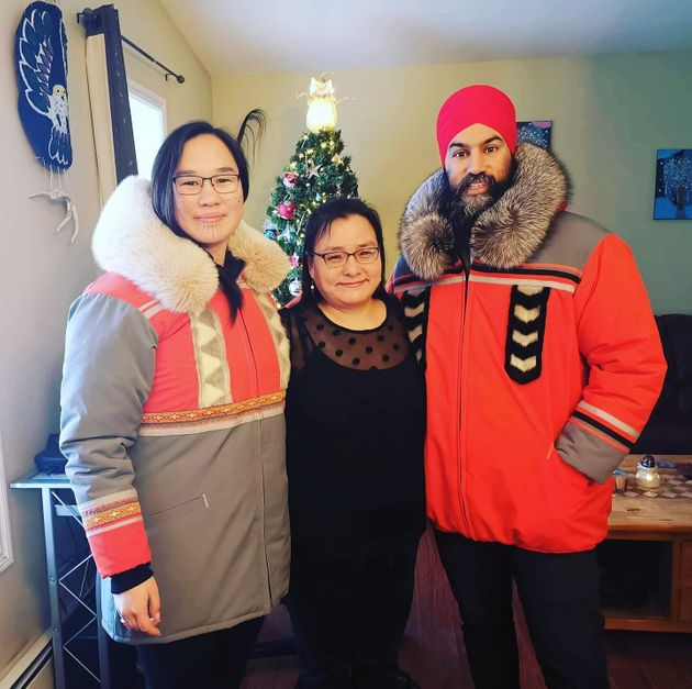 Marlene Watson, centre, stands with Jagmeet Singh and Mumilaaq Qaqqaq as they wear her handmade