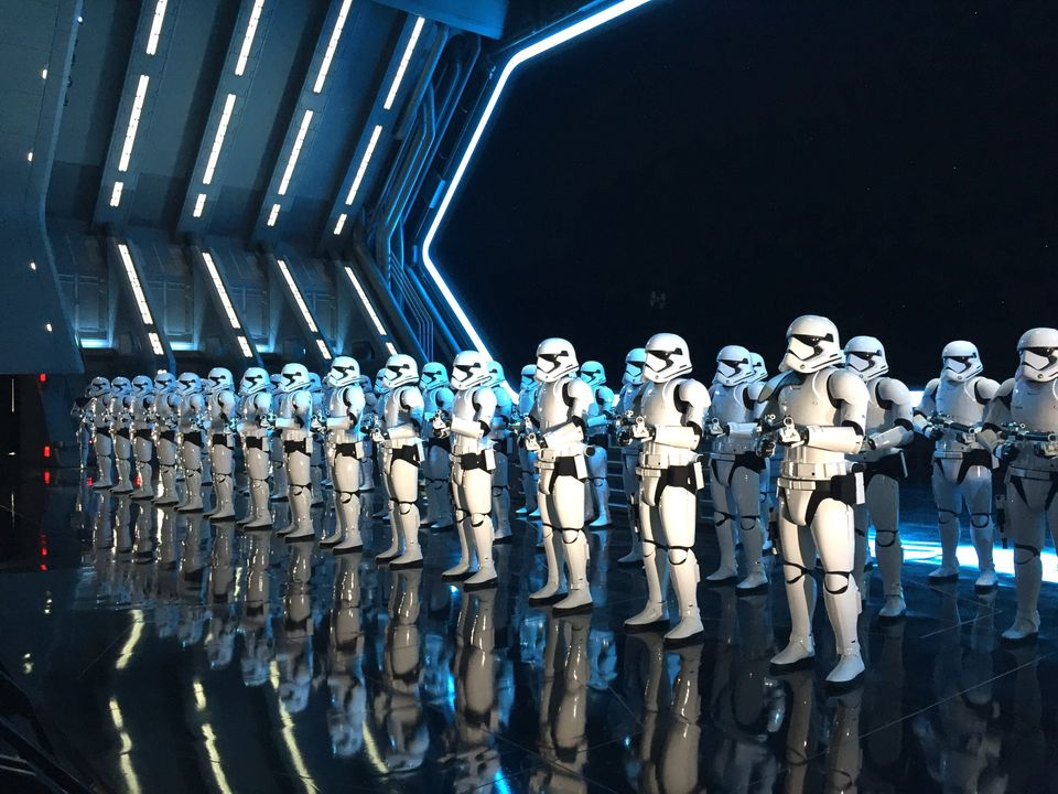 "Stormtroopers keep watch over ""captured"" guests at Star Wars: Rise of the Resistance at Disney's Hollywood Studios in Florida"
