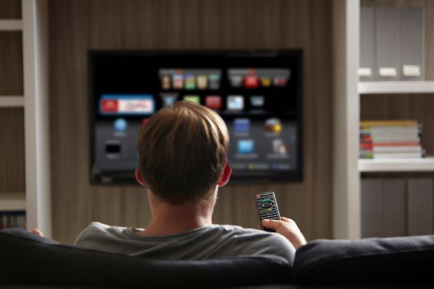 A man watches television on a smart TV in this undated stock photo. The FBI says it's important to know...