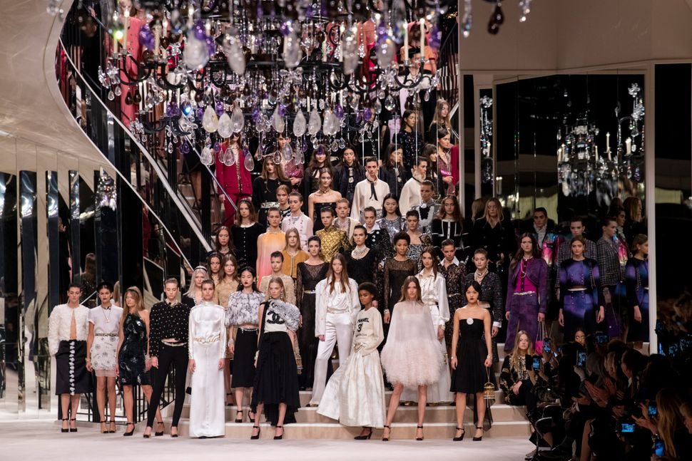 PARIS, FRANCE - DECEMBER 04: Models pose on the runway during the Chanel Metiers d'Art 2019-2020 show finale at Le Grand Palais on December 04, 2019 in Paris, France. (Photo by Kristy Sparow/WireImage)