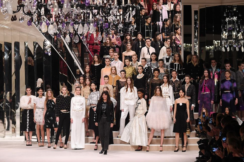 PARIS, FRANCE - DECEMBER 04: Models and Designer Virginie Viard pose on the runway during the Chanel Metiers d'art 2019-2020 show at Le Grand Palais on December 04, 2019 in Paris, France. (Photo by Pascal Le Segretain/Getty Images)