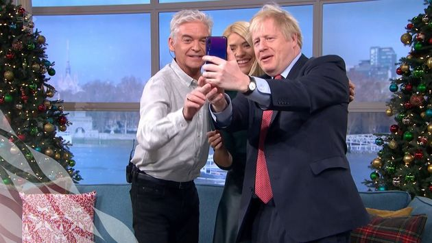 Phillip Schofield, Holly Willoughby and Boris Johnson take a selfie after the PM's This Morning