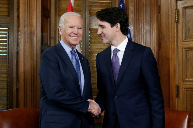 Canada's Prime Minister Justin Trudeau (R) shakes hands with U.S. Vice President Joe Biden during a meeting...