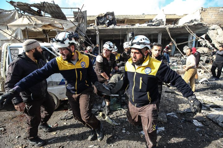 White Helmets and locals conduct search and rescue work after Assad regime forces carried out airstrikes targeting a Syrian marketplace on Dec. 2, 2019.