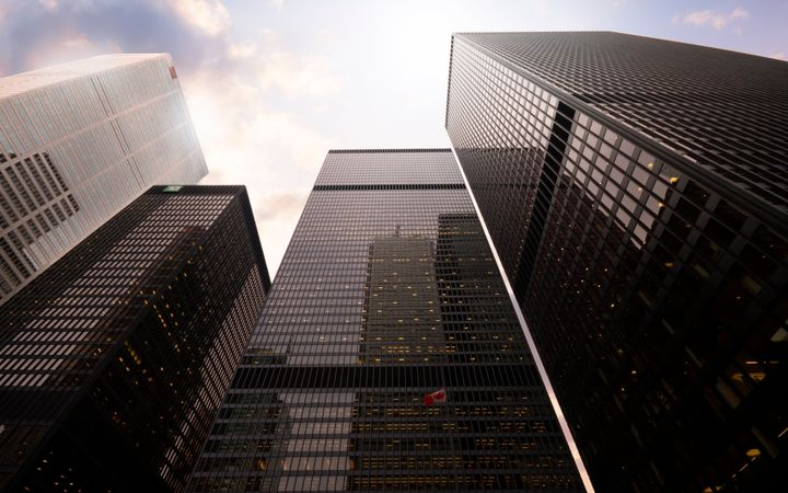 This stock photo shows the headquarters of some of the big Canadian banks in Toronto's financial district. Canada's big banks are setting aside much more money than before to cover loan losses.