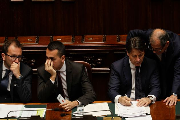 Italian Premier Giuseppe Conte, second from right, flanked by Labour Minister Luigi Di Maio, center,...