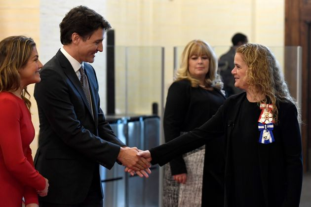 Governor General Julie Payette and Prime Minister Justin Trudeau greet one another before joining the...