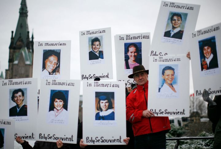 Demonstrators hold portraits of some of the women killed during the Polytechnique massacre.