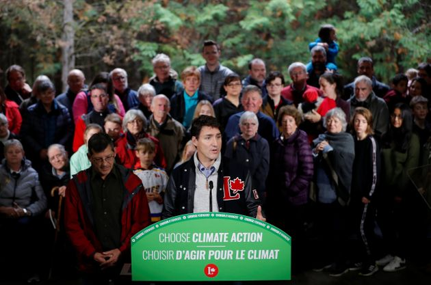 Liberal leader and Canadian Prime Minister Justin Trudeau attends a press conference after a tree planting...