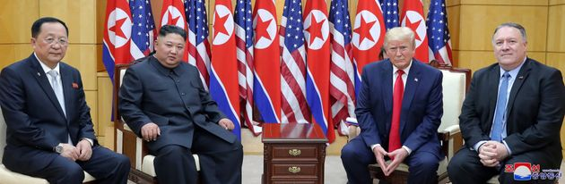 U.S. President Donald Trump and Secretary of State Mike Pompeo pose for a photo with North Korean leader...