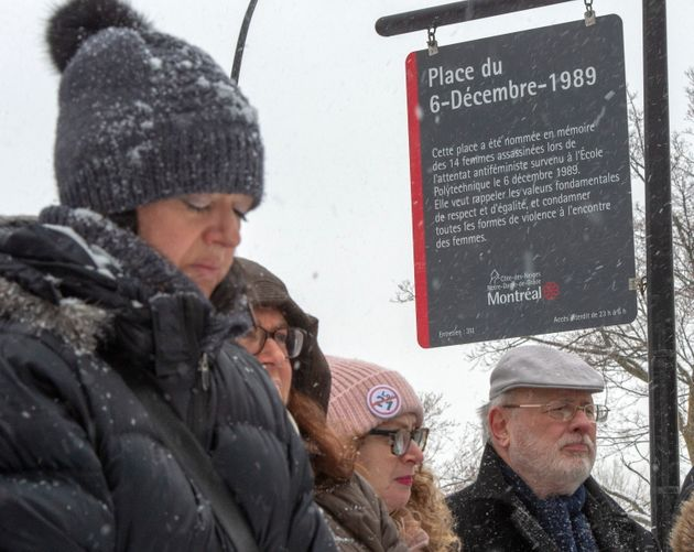People attend the inauguration of a new sign at Dec. 6th Park commemorating the 30th anniversary of the...
