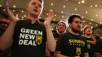 "WASHINGTON, DC - MAY 13:  Supporters of the ""Green New Deal"" participate in a rally at Howard University May 13, 2019 in Washington, DC. The Sunrise Movement held an event for the final stop of the ""Road to a Green New Deal"" tour to ""explore what the pain of the climate crisis looks like in D.C. and for the country and what the promise of the Green New Deal means.""  (Photo by Alex Wong/Getty Images)"
