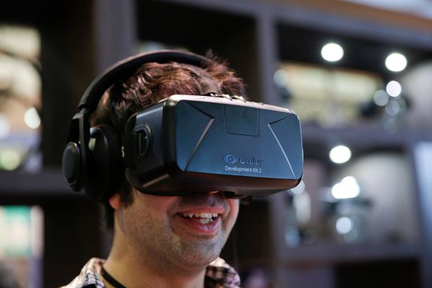 A man tries out the Oculus Rift virtual reality headset at the Oculus booth at the Electronic Entertainment...