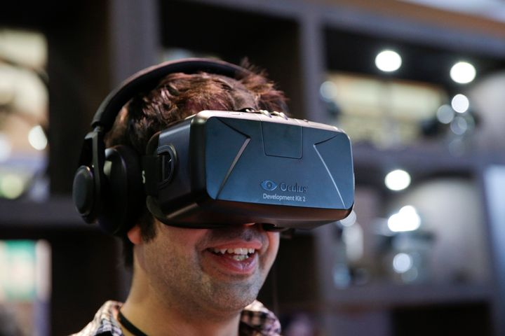 A man tries out the Oculus Rift virtual reality headset at the Oculus booth at the Electronic Entertainment Expo on Wednesday, June 11, 2014.