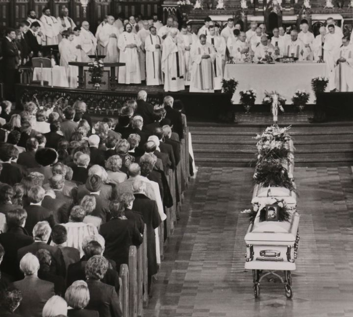 Four caskets lead to the altar where priests perform a high requiem mass for nine of the fourteen women victims of the December 6, 1989 mass shooting at Ecole Polytechnique, in Montreal on Dec. 11, 1989.