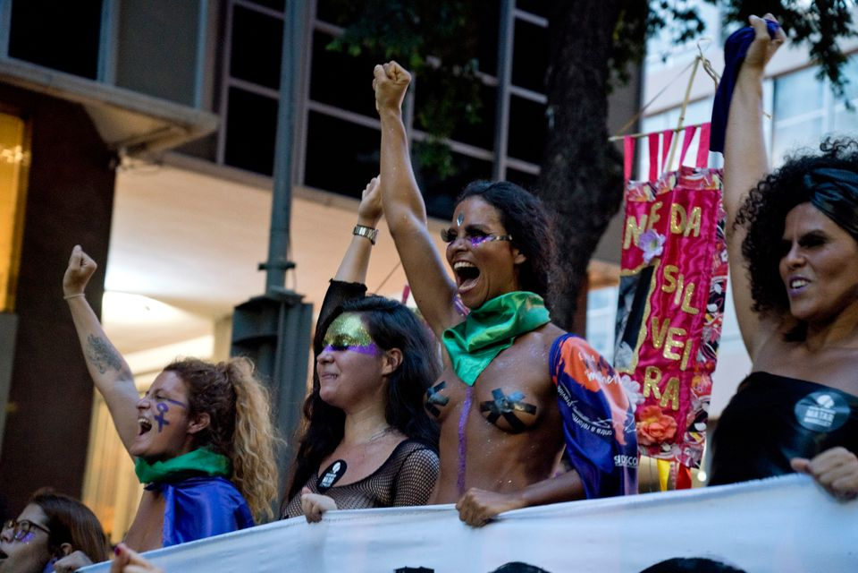 Mulheres marcham em protesto no dia 8 de março, Dia Internacional da Mulher, no Rio de Janeiro,...
