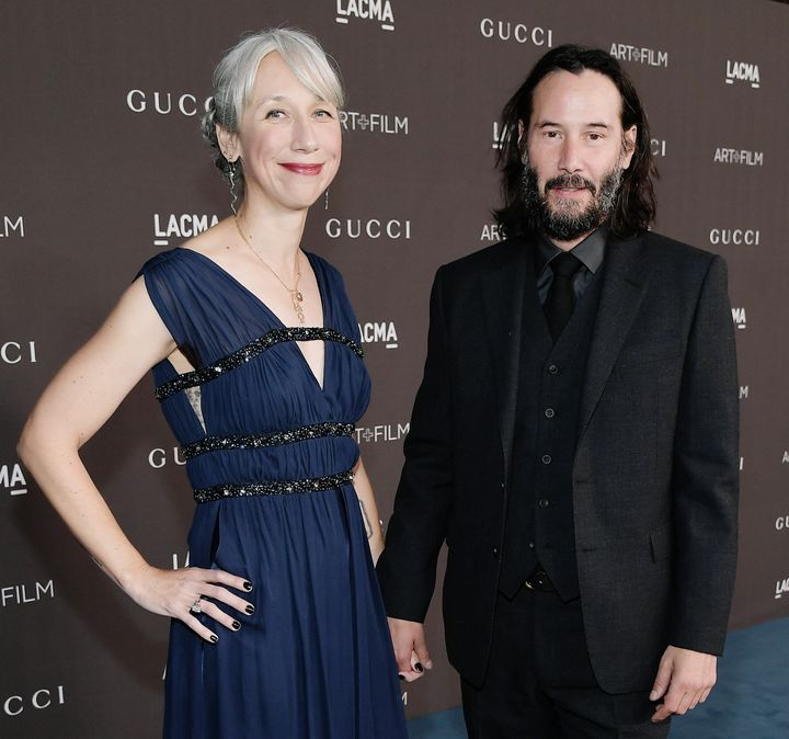 Alexandra Grant and Keanu Reeves hold hands at a Los  2019 LACMA 2019 Art + Film Gala in November.