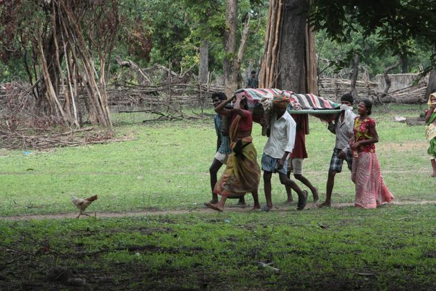 A family carries the body of a villager slain by Indian security forces. 17 villagers in Chhattisgarh...