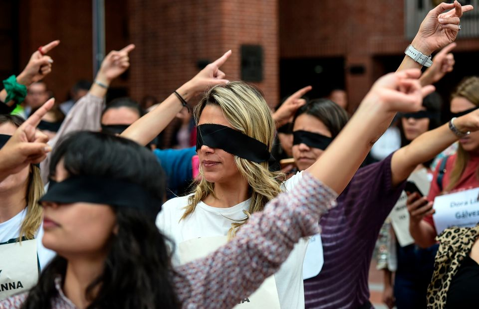 Colombian journalists take part in a choreographed performance originated in Chile, and inspired by the...